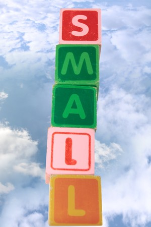 childrens toy letter building blocks against a cloudy background spelling small Stock Photo - 7478022