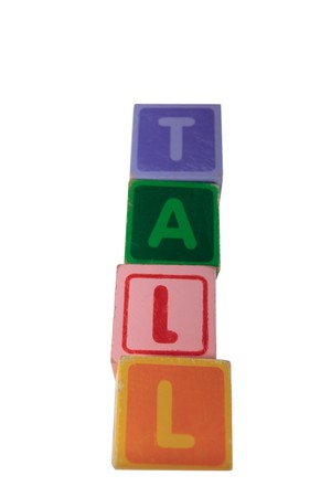 childrens toy letter building blocks against a white background spelling tall  Stock Photo - 7478009