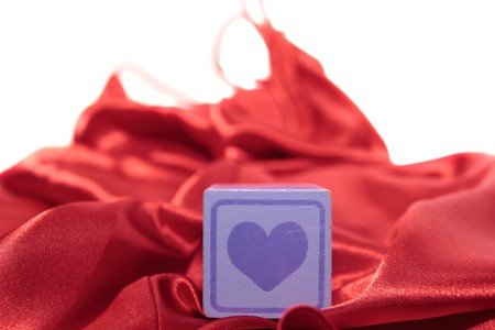 silky lingerie: love heart on block on a silk nightie against white background Stock Photo