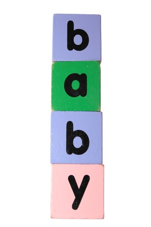assorted childrens toy letter building blocks against a white background that spell baby   photo