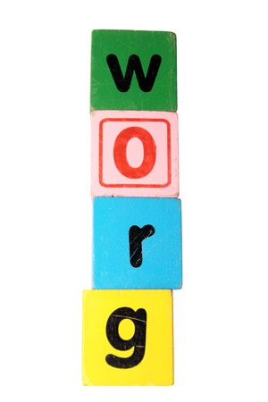 assorted childrens toy letter building blocks against a white background that spell grow  photo