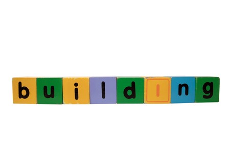 toy letters that spell building with white background photo