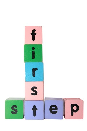 toy letter that spell first step against a white background  photo