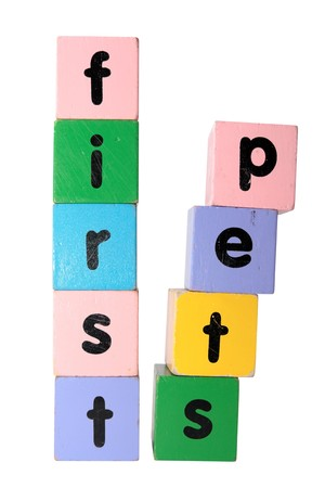 toy letters that spell first step against a white background  photo