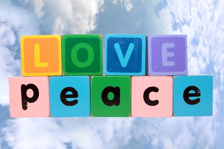 toy letters that spell love and peace with cloudy background  photo