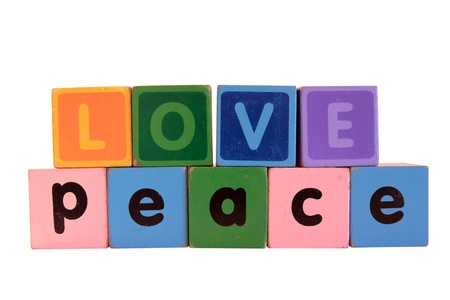 toy letters that spell love and peace with white background Stock Photo - 7681959