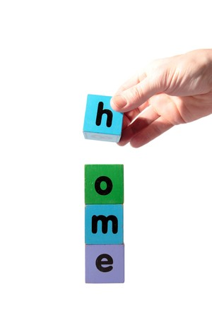 toy letters that spell home against a white background  photo