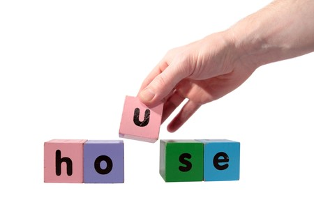 toy letters that spell house against a white background   photo