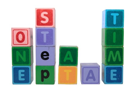 toy letters that spell one step at a time against a white background