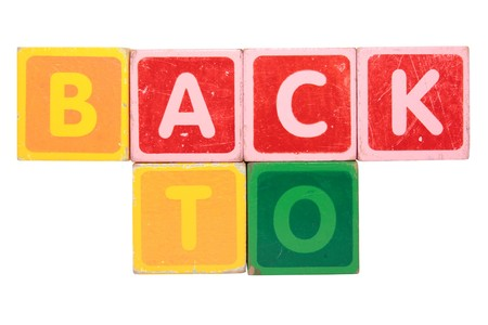 toy letters that spell back to against a white background  Stock Photo - 8097768