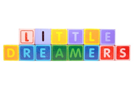 toy letters that spell little dreamers against a white background photo