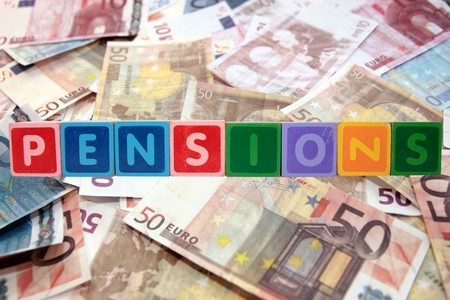 toy letters that spell pensions against a cash background photo