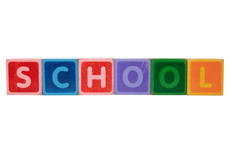 toy letters that spell school against a white background photo