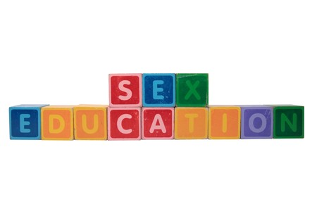 sex toy: blocks that spell sex education against a white background Stock Photo