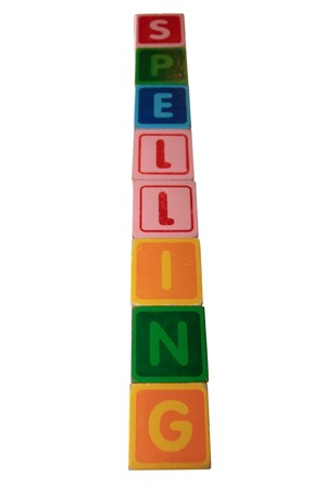 toy letters that spell spelling against a white background photo