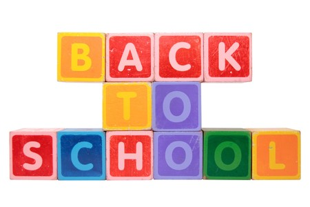 toy letters that spell back to school against a white background Stock Photo - 8098126