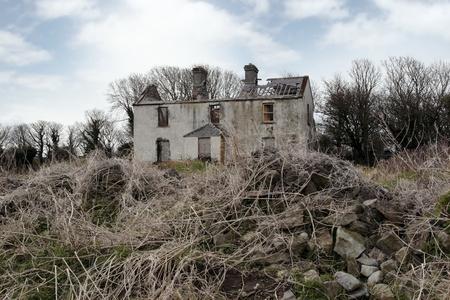 abandoned farmhouse abandoned farmhouse: an old abandoned overgrown farmhouse in ireland Stock Photo