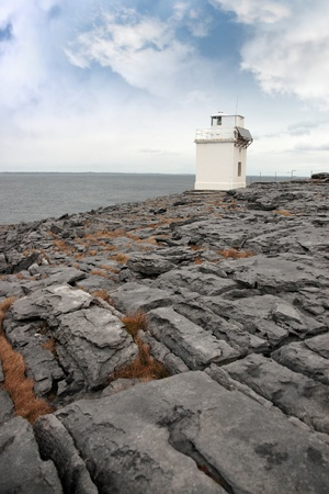 burren: lighthouse on rocky landscape of the burren in county clare ireland