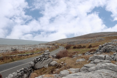 burren: road winding through the rocky lanscape of the burren in county clare ireland