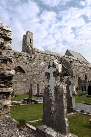 ancient celtic crosses in the graveyard of an old irish church Stock Photo - 8425527