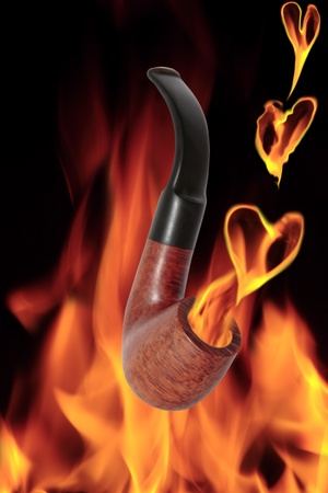 smoke from a smokers pipe saying new year resolutions on flaming background  photo