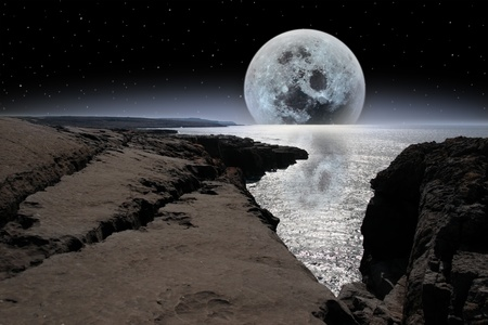 cliffs and coastline of the burren in county clare ireland with bright moon in night sky