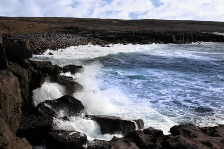 cliffs and coastline of the burren in county clare ireland with waves crashing on the rocks photo