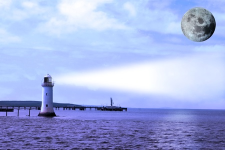 a lighthouse on the mouth of the river shannon with a full moon photo