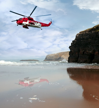 rescue helicopter: a sea rescue helicopter searching for person near to the cliffs on search and rescue mission in ballybunion county kerry ireland
