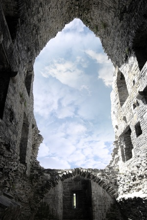 Ruins of a five-storeyed rectangular towerhouse within a bawn Partly destroyed in the 17th century in Ballylongford county kerry ireland from the inside photo