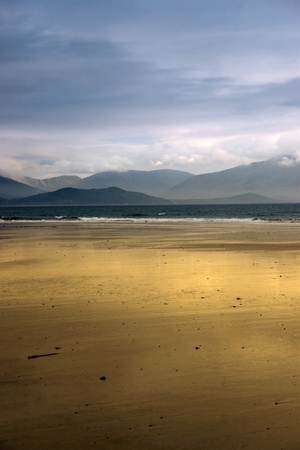 golden beach with blue sky and clouds in the maharees on the Dingle Peninsula Ireland with copy space photo