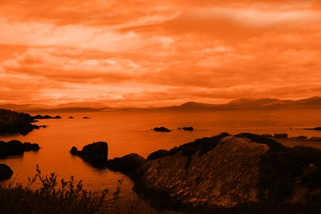 kerry: kerry scenic view in ireland with mountains against a beautiful red sunset cloudy sky