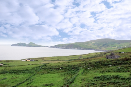 scenic view in kerry ireland of fields coastline and islands photo
