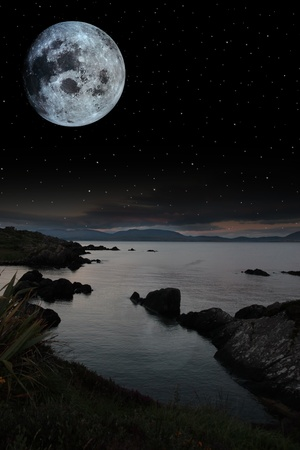 night scenic view in kerry ireland of rocks and sea with mountains against a beautiful blue cloudy sky Stock Photo - 10367310