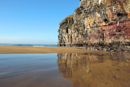 cliff face: icicles on a cliff face on ballybunion beach in ireland on a winters morning
