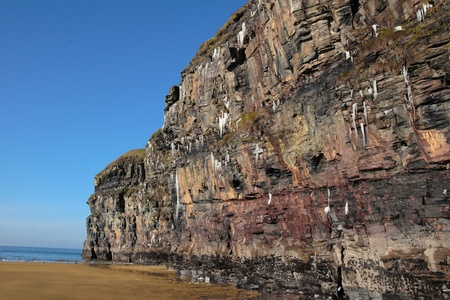 icicles on a cliff face on ballybunion beach in ireland on a winters morning photo