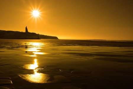 ballybunion: a scenic view of a castle on the irish coastline at ballybunion at sunset Stock Photo