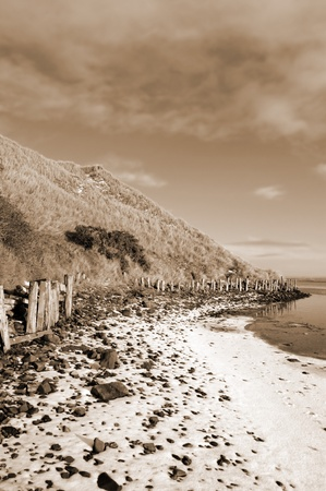 the cashen ballybunion frozen on a cold grey winters day in ireland in sepia photo