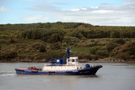 FOYNES HARBOUR, IRELAND -June 2011: celtic rebel tug boat at foynes ireland after bringing in large carriers taking cargo of bauxite to the Rusal Alumina plant at Aughinish in Co. Limerick Editorial