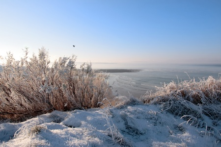 a seasonal snow covered view of atlantic ocean and ballybunion beach on a frosty snow covered winters day photo