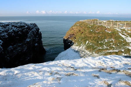 ballybunion: christmas winters view of the ballybunion cliffside walk with snowfall on the ground