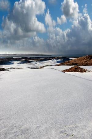 snow covered links golf course in ireland in winter photo