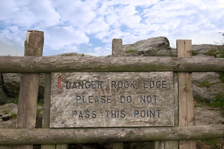 steep cliff sign: danger rock edge please do not pass this point sign in the county of Staffordshire in England