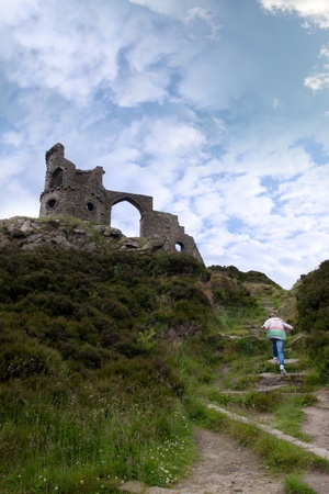 a young girl climbing to mow cop castle in the Biddulph valley in the county of Staffordshire in England photo