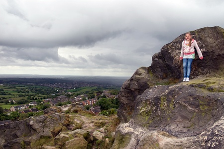 girls view from a rocky cliff in the Biddulph valley in the county of Staffordshire in England photo