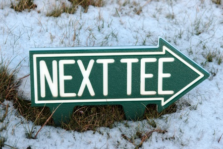the next tee sign on an irish golf course in the winters snow