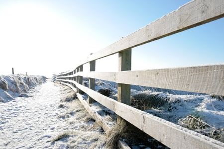 ballybunion: frosty winters view at ballybunion cliffside walk with bright sun and fence
