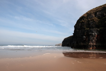 co kerry: a view of the beach cliffs in ballybunion co kerry ireland with reflection