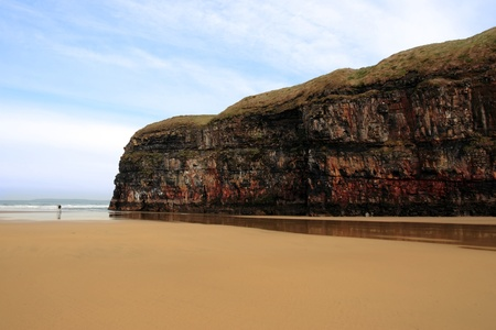 co  kerry:  a view of a loving couple walking the beach cliffs in ballybunion co kerry ireland