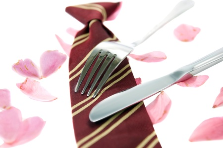dinners: knife and fork with a school tie as concept for loving school dinners